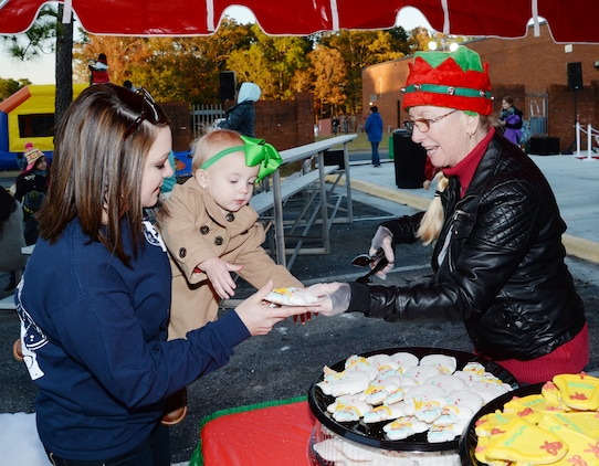 A hungry child reaches for her cookie during a Christmas Tree Lighting Ceremony at Marine Corps Logistics Base Albany, Dec. 9.