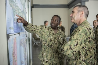 U.S. Navy Rear Adm. Cedric Pringle, left, commander of Joint Task Force Matthew, and Rear Adm. Roy Kitchener, commander of Expeditionary Strike Group 2, visits Joint Task Force Matthew Headquarters to discuss current and future relief efforts in Port-au-Prince, Haiti, Oct. 9, 2016.  JTF Matthew, a U.S. Southern Command-directed team, is comprised of Marines with Special Purpose Marine Air-Ground Task Force - Southern Command and soldiers from Joint Task Force-Bravo's 1st Battalion, 228th Aviation Regiment, deployed to Port-au-Prince at the request of the Government of Haiti on a mission to provide humanitarian and disaster relief assistance in the aftermath of Hurricane Matthew. (U.S. Marine Corps photo by Cpl. Kimberly Aguirre)