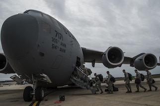 More than 30 members of the 621st Contingency Response Wing board a C-17 Globemaster III at Joint Base McGuire-Dix-Lakehurst, N.J., October 8, 2016. The Airmen are on their way to Port-au-Prince, Haiti, responding to Hurricane Matthew. The CRW has a history of supporting humanitarian aid and disaster relief operations, including the earthquake in Haiti in 2010 when its Airmen supported more than 150 flights per day, coordinating the delivery of 3.5 million tons of relief cargo. (U.S. Air Force photo by Tech. Sgt. Gustavo Gonzalez/Released)