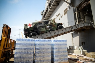 NORFOLK (Oct. 7, 2016) A medical vehicle attached to the 24th Marine Expeditionary Unit (24th MEU), drives aboard the  amphibious assault ship USS Iwo Jima (LHD 7) during an onload of more than 500 Marines from the 24th Marine Expeditionary Unit and nearly 300 pallets of supplies. Iwo Jima is moored pierside at Naval Station Norfolk awaiting further tasking as Hurricane Matthew develops. (U.S. Navy photo by Petty Officer 3rd Class Jess E. Toner/Released)