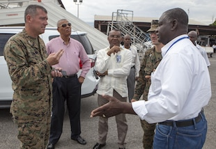 Colonel Thomas Prentice, commanding officer of Special Purpose Marine Air-Ground Task Force – Southern Command, discusses possible staging areas for helicopters that will be utilized during relief operations to provide aid to areas affected by Hurricane Matthew, with Ernst Renaud, director of Toussaint Louverture International Airport at Port-au-Prince, Haiti, Oct. 6, 2016. Having staging areas at the airport are critical in providing timely relief to the affected areas of Haiti. SPMAGTF-SC Marines and soldiers from Joint Task Force-Bravo's 1st Battalion, 228th Aviation Regiment are a part of Joint Task Force Matthew, a U.S. Southern Command-directed team deployed to Port-au-Prince at the request of the Government of Haiti, on a mission to provide humanitarian and disaster relief assistance in the aftermath of Hurricane Matthew.