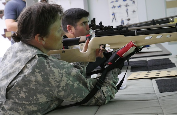 U.S. Army Staff Sgt. Tiffany Rodriguez-Rexroad, Bravo Company, Warrior Transition Battalion, Brooke Army Medical Center, inspects her air rifle before firing during a training session at Central Catholic High School, San Antonio, Texas, Nov. 10, 2016. The training is part of the WTB's adaptive reconditioning program.  (U.S. Army photo by Robert A. Whetstone/Released)