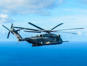 A section of CH-53E Super Stallion Helicopters flew to Grand Cayman Island in order to ensure rapid response to Hurricane Matthew if requested to do so from Soto Cano Air Base, Honduras, Oct. 4, 2016. The SPMAGTF-SC is part of a U.S Southern Command response team staged at Grand Cayman Island, ready to support U.S disaster relief operations in the Caribbean in response to Hurricane Matthew. SPMATF-SC deployed to Central America in June to serve as a rapid response force during the hurricane season. (U.S. Marine Corps photo by Capt. Tyler Hopkins//released)