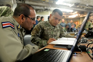 GULF OF PANAMA (Sept. 24, 2016) - Lt. Randall Mena, of Costa Rica, and Lt. j.g. Ovidio Tenorio, from the Republic of Panama, conduct operational planning during the UNITAS 2016 exercise portion on board USNS Spearhead (T-EPF 1). UNITAS is an annual multi-national exercise that focuses on strengthening our existing regional partnerships and encourages establishing new relationships through the exchange of maritime mission-focused knowledge and expertise throughout the exercise. (U.S. Navy Photo by Mass Communication Specialist 1st Class Jacob Sippel/RELEASED)