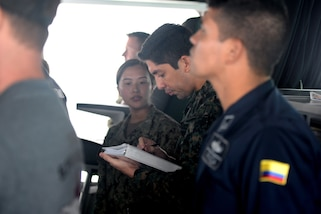 GULF OF PANAMA (Sept. 23, 2016) - Lt. Eder Suclla, of Peru, coordinates 18 ships from 11 countries, forming around USNS Spearhead (T-EPF 1), as part of a multinational ship movement exercise. UNITAS is an annual multi-national exercise that focuses on strengthening our existing regional partnerships and encourages establishing new relationships through the exchange of maritime mission-focused knowledge and expertise throughout the exercise. (U.S. Navy Photo by Mass Communication Specialist 1st Class Jacob Sippel/RELEASED)
