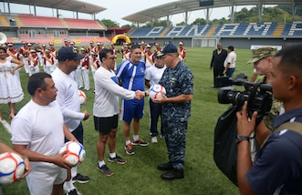 PANAMA CITY, Panama (Sept. 20, 2016) - Rear Adm. Robert Greene, Deputy Commander, U.S. Naval Forces Southern Command, gives UNITAS partner nations gift of soccer balls during a day of sports at the Estadio Maracaná de Panamá soccer stadium. UNITAS is an annual multi-national exercise that focuses on strengthening our existing regional partnerships and encourages establishing new relationships through the exchange of maritime mission-focused knowledge and expertise throughout the exercise. (U.S. Navy Photo by Mass Communication Specialist 1st Class Jacob Sippel/RELEASED)