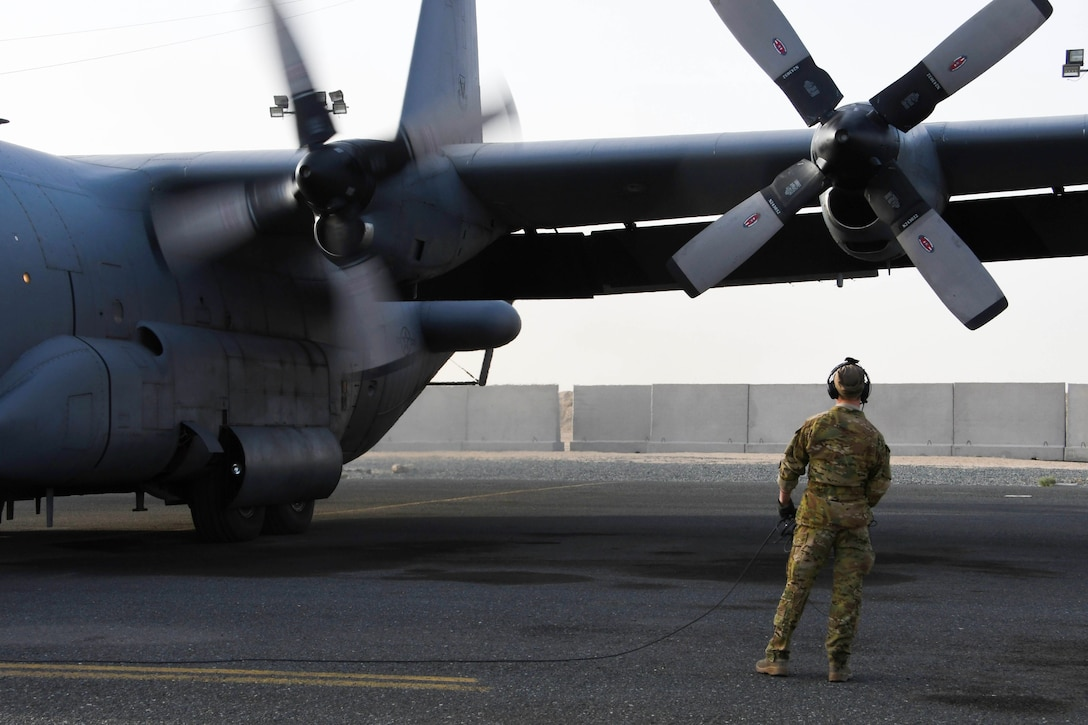 A 386th Expeditionary Operations Group airborne maintenance technician monitors an EC-130H Compass Call as it starts its engines on Dec. 5, 2016 at an undisclosed location in Southwest Asia. The Compass Call is engaged in operations jamming Da'esh communications in order to confuse and disorient enemy fighters. (U.S. Air Force photo by Senior Airman Andrew Park)