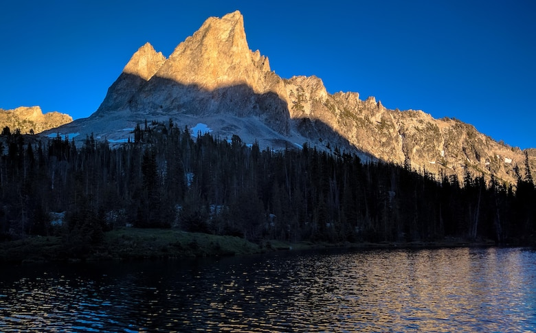 The last remaining daylight slips off El Capitan Mountain above Alice Lake, Idaho, July 16th, 2016. Alice Lake is one of several alpine lakes chained beneath the mountain. (U.S. Air Force photo by Senior Airman Connor J. Marth/Released)