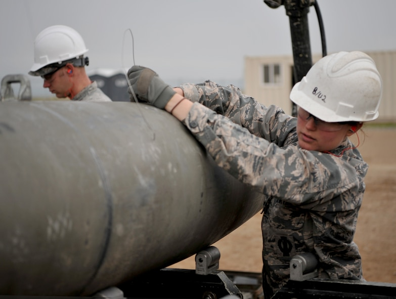 Airmen work together to build a munition at the munitions pad Dec. 13, 2016, at Beale Air Force Base, California. The Airmen are currently in a munitions career field upgrade training course at the Air Force Combat Ammunition Center. (U.S. Air Force photo/Staff Sgt. Jeffrey Schultze)