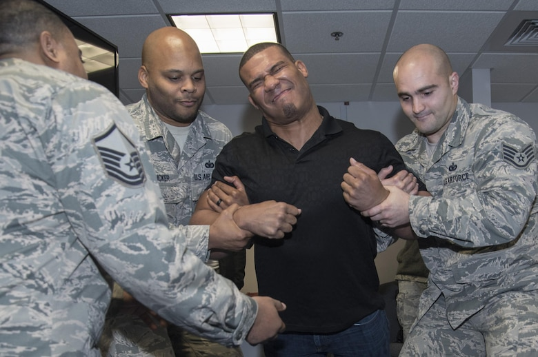 Jason Jordan, World Wrestling Entertainment Superstar, participated in a taser demonstration conducted by 11th Security Support Squadron members at Joint Base Andrews, Md., Dec. 13, 2016. In addition to experiencing security forces training requirements like tasing, the Superstars viewed combat gear, weapons systems and other aspects of the unit. The group visited JBA to see and broadcast the missions of Airmen here and gain a more comprehensive understanding of the roles of the service members. (U.S. Air Force photo by Senior Airman Jordyn Fetter)