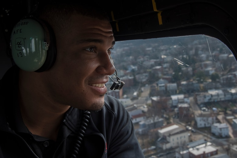 Jason Jordan, World Wrestling Entertainment Superstar, looks out the window of a UH-1N Iroquois helicopter above the National Capital Region of Washington, D.C., Dec. 13, 2016. The 1st Helicopter Squadron provided the Superstars a rare tour of the National Capital Region aboard their aircraft, showing them national monuments like the Washington Monument, U.S. Capital Building and Martin Luther King, Jr. Memorial. (U.S. Air Force photo by Senior Airman Jordyn Fetter)