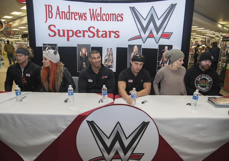 World Wrestling Entertainment Superstars prepare for a signing event at Joint Base Andrews, Md., Dec. 13, 2016. The Superstars spent the morning touring JBA as a way to show their appreciation for the sacrifices military members have made, give back to the community and understand some of the missions that make up the armed forces. (U.S. Air Force photo by Senior Airman Jordyn Fetter)