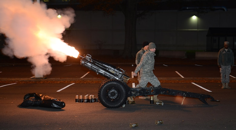 U.S. Army Soldiers fire cannons during the annual holiday run in recognition of their successful donations to the U.S. Marine Corp's Toys for Tots program at Joint Base Langley-Eustis, Va., Dec. 9, 2016. The 2.2 mile run. (U.S. Air Force photo by Staff Sgt. Teresa J. Cleveland)