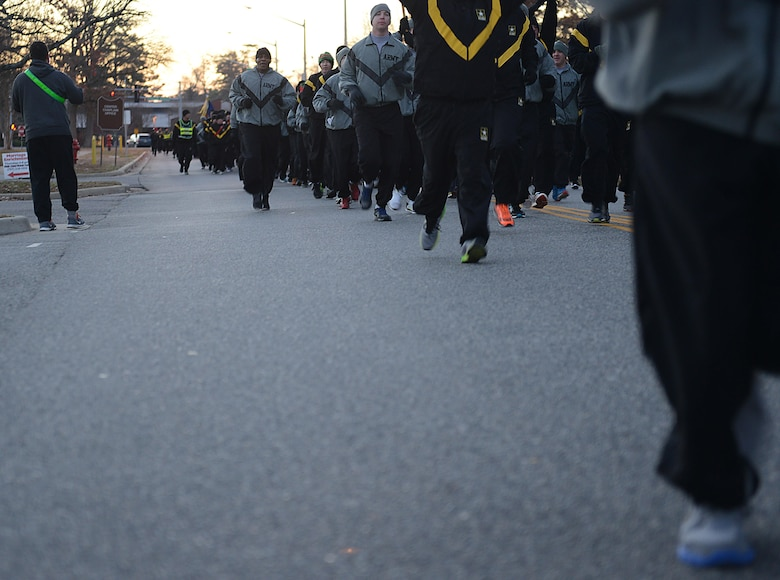 U.S. Army Soldiers run in formation during the annual U.S. Marine Corp's Toys for Tots holiday run at Joint Base Langley-Eustis, Va., Dec. 9, 2016. Installation leadership supported the runners by running alongside them and cheering them on at the finish line. (U.S. Air Force photo by Staff Sgt. Teresa J. Cleveland)