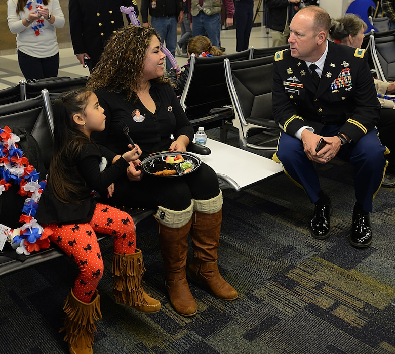 Adriana Quintana, age 5, and her mother Nilda Quintana, Gold Star family members from Hampton Roads, Va., speak with U.S. Army Col. Ralph Clayton III, 733rd Mission Support Group commander, during the Snowball Express at Norfolk International Airport, Va., Dec. 11, 2016. Nilda's husband, Daniel Quintana, passed away while on active duty in 2011, just three months before Adriana was born. (U.S. Air Force photo by Staff Sgt. Teresa J. Cleveland)