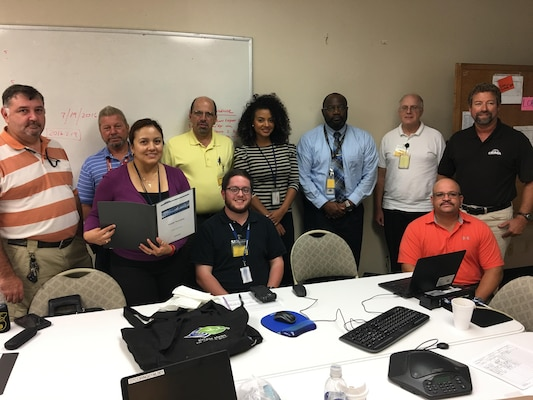 Eleven Defense Contract Management Agency Orlando employees attended a one-day workshop, Product Quality Deficiency Report Workshop, which focused on detection to prevention and other surveillance methods, Sept. 14. Front row: Nadia Aponte, Gregory Abramowitz and Jose Melendez. Back row: Les Jones, Major Yarborough, Paul Giannetti, Carisse Zorrilla-Medina, Tommy Moody, Paul Harrison, and Odin Keller. Absent from photo is Lance Woods and Count Kately. (Photo courtesy of DCMA Orlando)