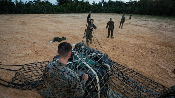 Marines assigned to Landing Support Platoon, Combat Logistics Battalion 31, 31st Marine Expeditionary Unit, set up a landing zone with a load of tires and sandbags as part of external lift operations training at Landing Zone Falcon, Okinawa, Japan, Dec. 8, 2016. CLB-31 conducted the training with Marine Medium Tiltrotor Squadron 262 (Reinforced) to complete qualifications for the 31st MEU's upcoming spring deployment. As the Marine Corps' only continuously forward-deployed unit, the MEU's air-ground-logistics team provides a flexible force, ready to perform a wide range of military operations, from limited combat to humanitarian assistance operations, throughout the Indo-Asia-Pacific region.