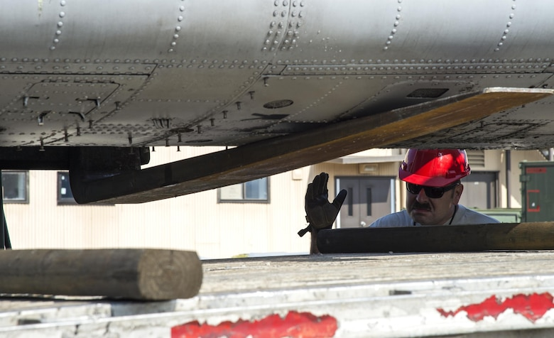 Tech. Sgt. Thomas Breining, 23d Equipment Maintenance Squadron repair and reclamation NCO in charge directs a forklift lowering the fuselage of an A-10A Thunderbolt II onto a flatbed truck, Dec. 1, 2016, at Moody Air Force Base, Ga. A lot of A-10As received upgrades in technology that converted them to A-10Cs, but few remained as static displays, training aircraft and spare parts for the upgraded aircraft. (U.S. Air Force photo by Staff Sgt. Eric Summers)