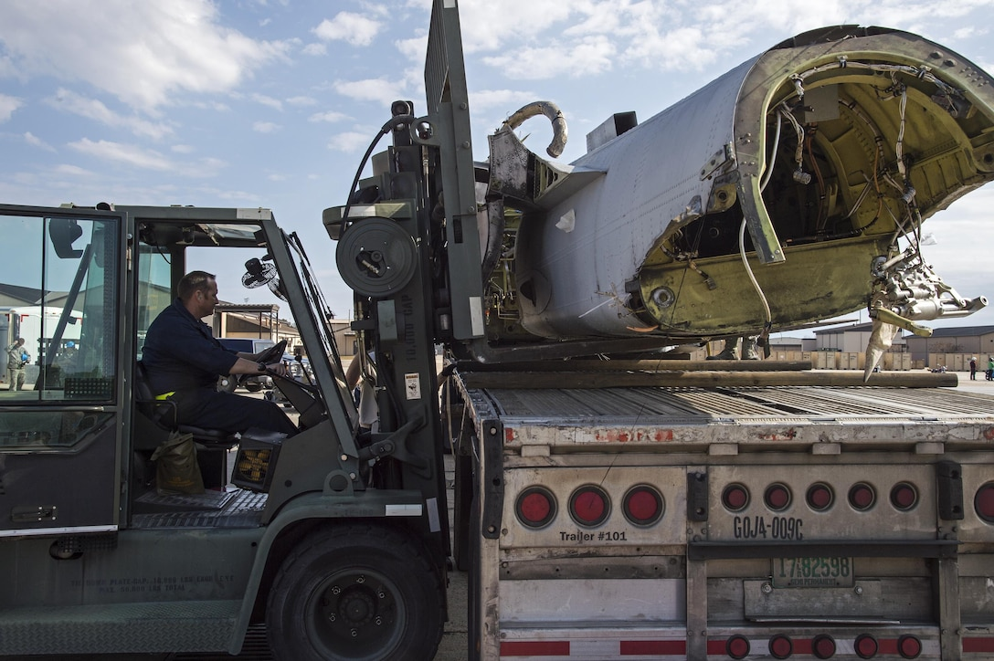 Tech. Sgt. Richard Paulk 23d Equipment Maintenance Squadron repair and reclamation craftsman uses a forklift to lower the fuselage of an A-10A Thunderbolt II onto a flatbed truck, Dec. 1, 2016, at Moody Air Force Base, Ga. This was Moody's last A-10A which was manufactured in 1980 in Baltimore, Md., and was officially completed on Nov. 3, 1981. (U.S. Air Force photo by Staff Sgt. Eric Summers)