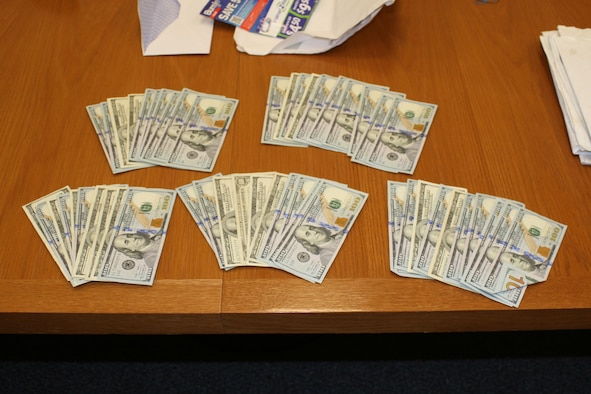 This is the $5,000 seized as evidence following the completion of a bribe made by a sub-contractor to an Air Force Office of Special Investigations informant. The bribe was intended to overlook wiring discrepancies regarding a contract held by a communications company on Joint Base Elmendorf-Richardson, Alaska. (U.S. Air Force photo/OSI Det. 631)