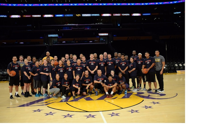 Serving like a Champion, the Space and Missile Systems Center team meet at half court with members of the 16-time NBA Champions Los Angeles Lakers. (U. S. Air Force photo by Van De Ha)