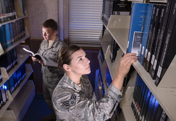 Producing mission data begins with research. Senior Airman Chad and Senior Airman Elizabeth, research analysts, study a variety of aircraft in the 57th IS library. The library, located within 25th Air Force Headquarters, is one of only a few official Air Force libraries.