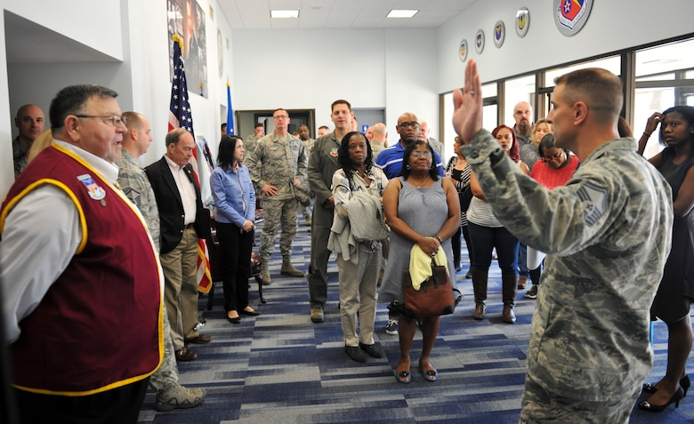 U.S. Air Force Senior Master Sgt. Robert Compton, Paul W. Airey NCO Academy director of education, prepares to lead a tour of the academy at Tyndall Air Force Base, Fla., Dec. 13, 2016. Each classroom throughout the academy is named after  enlisted Airmen  who were hand-picked by NCO Academy classes for their unwavering heroism and courage. (U.S. Air Force photo by Senior Airman Dustin Mullen/Released)