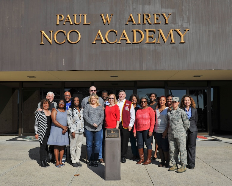 Honorees of the Paul W. Airey NCO Academy's Legacy of Valor event gather in front of the academy at Tyndall Air Force Base, Fla., Dec. 13, 2016. During the event, honorees toured the NCO Academy and were given a chance to see the rooms named after them or their loved ones. (U.S. Air Force photo by Senior Airman Dustin Mullen/Released)