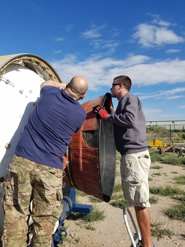 Volunteers from the Space and Missile Systems Center Launch Enterprise Directorate's Experimental Launch and Test Division based at Kirtland Air Force Base, New Mexico restore a Peacekeeper Intercontinental Ballistic Missile for an exhibit recently unveiled at the National Museum of Nuclear Science and History's Heritage Park. The volunteers spent the past year working on the display during their off-duty time.