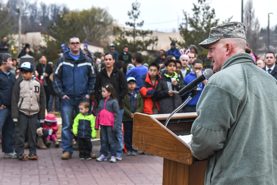 Col. Andrew Hansen, 51st Fighter Wing commander, addresses service members and their families at the opening of the Christmas tree lighting ceremony at Osan Air Base, Republic of Korea, Dec. 8, 2016. Hansen encouraged everyone to support and care for themselves and to not miss out on any festivities going on around the base. (U.S. Air Force photo by Tech. Sgt. Rasheen Douglas)