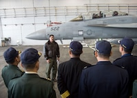 U.S. Navy Lt. Shaun Randall, the Naval Air Facility Misawa VAQ-135 training officer, briefs Japanese and Republic of Korea colonels and lieutenant colonels on the mission and capabilities of the EA-18G Growler at Misawa Air Base, Japan, Dec. 13, 2016. In addition to seeing the EA-18G, Japanese and Republic of Korea leaders listened to a mission brief on the F-16 Fighting Falcon and the Air Force's presence in Misawa. (U.S. Air Force photo by Senior Airman Deana Heitzman)