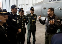 U.S. Navy Cmdr. Kevin Volpe, VAQ-135 electronic warfare officer, briefs Japanese and Republic of Korea colonels and lieutenant colonels on the mission and capabilities of the EA-18G Growler at Misawa Air Base, Japan, Dec. 13, 2016. The Japanese and Republic of Korea leaders are a part of a Senior Officers Leadership Course touring Japanese military installations across the Aomori Prefecture and Hokkaido, Japan. (U.S. Air Force photo by Senior Airman Deana Heitzman)