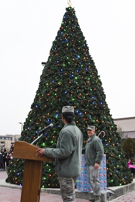 Col. Andrew Hansen, 51st Fighter Wing commander, smiles as he pulls the switch to light up the Christmas tree during the lighting ceremony at Osan Air Base, Republic of Korea, Dec. 8, 2016. The tree lighting ceremony began with the Osan Chapel Children's Choir singing Christmas carols, the lighting of the Christmas tree, and ending the evening with a visit from Santa Claus. (U.S. Air Force photo by Tech. Sgt. Rasheen Douglas)