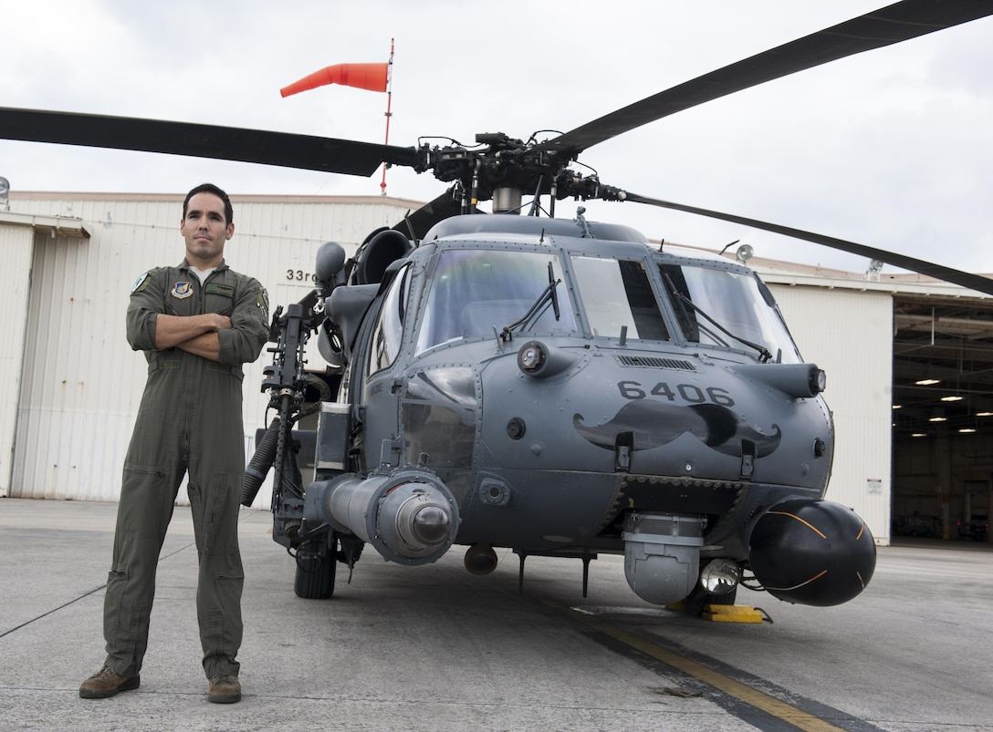 U.S. Air Force Maj. Anibal Aguirre, 33rd Rescue Squadron weapons and tactics officer, piloted one of the HH-60G Pave Hawks during the rescue of five MV-22 Osprey crewmembers Dec. 13, 2016. Members of the 33rd RQS participated in the successful rescue of the Marines alongside members of the 31st RQS, Japan Air Self-Defense Force and the Japan Coast Guard following a shallow water landing off the coast of Okinawa near Camp Schwab. (U.S. Air Force photo by Senior Airman Lynette M. Rolen/Released)