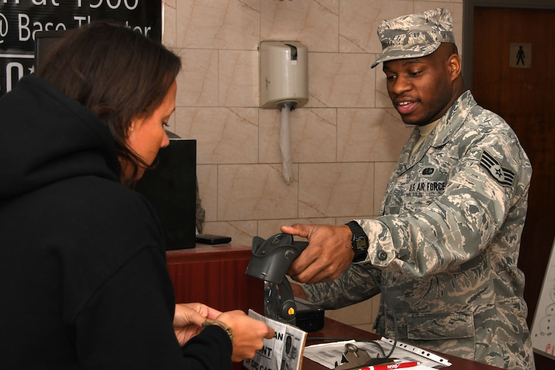 Staff Sgt. Tyrone Johnson, a 386th Expeditionary Force Support Squadron services journeyman, greets a diner at the Deserts Winds Dining Facility at an undisclosed location in Southwest Asia Dec. 15, 2016. Johnson is known for his cheerful and enthusiastic greetings as he welcomes diners to the Desert Winds each day. (U.S. Air Force photo/Senior Airman Andrew Park)