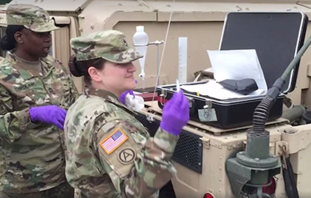 Defense Logistics Agency Energy Europe and Africa laboratory's noncommissioned officer Army Sgt. 1st Class Mandy Jo Allen demonstrates proper fuel assurance techniques at a fuel training exercises in Europe. Photo by 21st Theater Sustainment Command