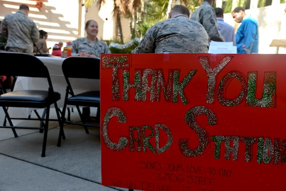 "Personnel assigned to the 6th Medical Group (MDG) write ""thank you"" cards during the 6th MDG appreciation event at MacDill Air Force Base, Fla., Dec. 14, 2016. Cards written by medical staff members and patients were hand-delivered to various personnel in the 6th MDG. (U.S. Air Force photo by Senior Airman Vernon L. Fowler Jr.)"