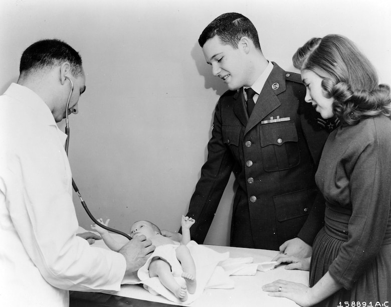 The Dependents' Medical Care Act, effective since Dec. 7, 1956, enabled dependents of military personnel to be treated by civilian doctors in cases of pregnancy, serious injuries, or illnesses requiring hospitalization.  The law also opened up medical facilities of all services and the U.S. Public Health Service to Air Force dependents.  The Dependents' Medical Care Act outlined operations of the program, specific exceptions, and eligibility requirements.  Here, an Airman and his wife get the final okay from the family doctor on the second visit.