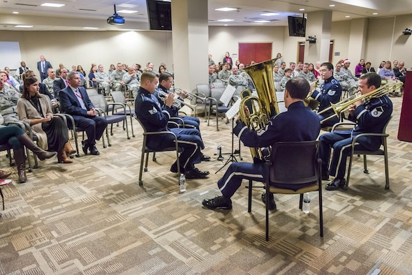 Tis the season for music courtesy of the U.S. Air Force Brass Quintet, shown as they perform holiday favorites Dec. 14 at the Russell Knox Building Collaboration Center, Marine Corps Base Quantico, Va. The ensemble of Air Force NCOs and Senior NCO's appeared at the invitation of the Air Force Office of Special Investigations headquarters. (U.S. Air Force photo/Michael Hastings)