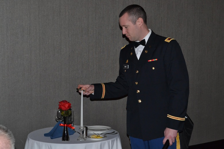 1st Lt. Richard Hicks lit the candle at the Table of the Fallen Soldier during the 3rd Battalion, 379th Regiment deactivation ceremony at Fort Smith, Arkansas on Dec. 10, 2016. Hicks also served as the Vice of Ceremony during the Mess, a dining in tradition that highlights the history and tradition of the unit. (Photo Credit: Sgt. 1st Class Emily Anderson)