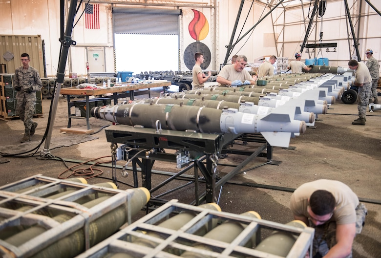 Airmen from the Vermont Air National Guard assemble 500-pound joint direct attack munitions from the at the 407th Air Expeditionary Group, Southwest Asia, Dec. 2, 2016. The munitions will be used by 134th Expeditionary Fighter Squadron F-16 Fighting Falcons while working with a coalition of about 60 regional and international nations to counter ISIL's campaign in Iraq and Syria. (U.S. Air Force photo/Master Sgt. Benjamin Wilson)(Released)