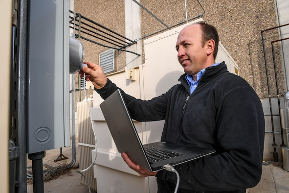 Aaron Erickson, 309th Maintenance Support Group energy manager, pulls high-resolution data from a meter at building 843, Hill Air Force Base, Dec. 13. The data will be analyzed for energy consumption trends and spikes. Erickson was recently named as the 2016 Energy Champion of the Year for the base. (U.S. Air Force photo by Paul Holcomb)