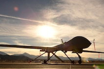 An MQ-1 Predator sits on the flight line Dec. 8, 2016, at Creech Air Force Base, Nev. The predator started as an RQ-1 in the late 1990s providing reconnaissance capabilities only until the early 2000s when it was equipped with two AGM-114 Hellfire missiles. (U.S. Air Force photo by Senior Airman Christian Clausen)