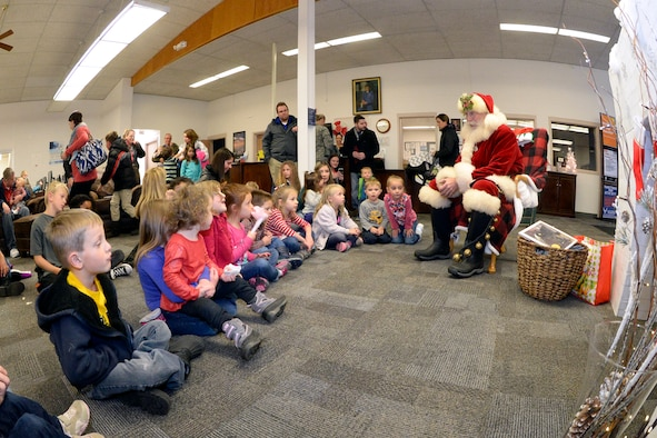 Santa visits with children during the Winter Wonderland celebration at the Hill Air Force Base Library, Dec. 8, 2016.  The event provided base families a chance to chat with Santa, enjoy refreshments, and participate in craft activities. (U.S. Air Force photo by Todd Cromar)