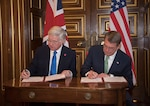 Defense Secretary Ash Carter and U.K. Defense Secretary Michael Fallon sign a carrier strategic guidance document in London before a meeting of defense ministers from nations participating in the coalition to counter the Islamic State of Iraq and the Levant, Dec. 15, 2016. DoD photo by Air Force Tech. Sgt. Brigitte N. Brantley
