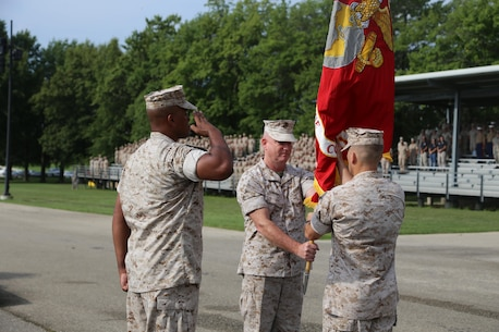 Colonel Daniel E. Longwell, Marine Corps Detachment, passes the Colors to Colonel George W. Markert at Fort Leonard Wood, MO, August 12, 2016. As the new Commanding Officer of Marine Corps Detachment Fort Leonard Wood, Col. Markert assume all duties and responsibilities. (U.S. Marine Corps photo by Sgt. Teng Yang)