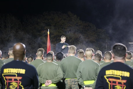 Col. George Markert, Commanding Officer, Marine Corps Detachment Fort Leonard Wood, briefs Marines after the run at Fort Leonard Wood, MO. Nov. 10, 2016. As the Commanding Officer, Col. Markert speaks about how critical each Military Occupational Specialties (MOS) impact the Marine Corps wide. (U.S. Marine Corps photo by Sgt. Teng Yang)