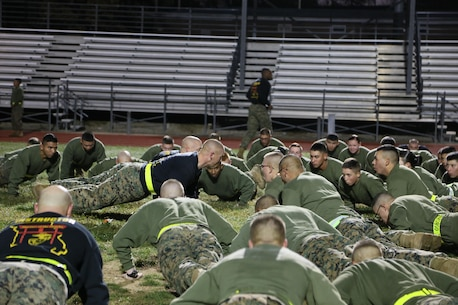 1stSgt Lee Legrande, Company 1stSgt, Engineers Equipment Instruction Company (EEIC), motivating the young Marines after the run at Fort Leonard Wood, MO. Nov. 10, 2016. As the Company 1stSgt for EEIC, 1stSgt Legrande continues to inspire the young and the old by creating camaraderie doing Marine Corps pushups. (U.S. Marine Corps photo by Sgt. Teng Yang)
