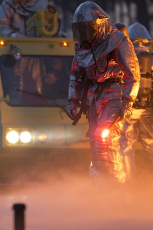 A Marine uses a flare to ignite jet fuel during a training exercise aboard Marine Corps Air Station Beaufort, Dec. 13. The Marines with Expeditionary Firefighting Rescue conducted the training to prepare for and hone skills necessary to face real life scenarios. The training also served as an opportunity to strengthen camaradarie and enhance trust among the unit members. The Marines are with EFR, Headquarters and Headquarters Squadron.
