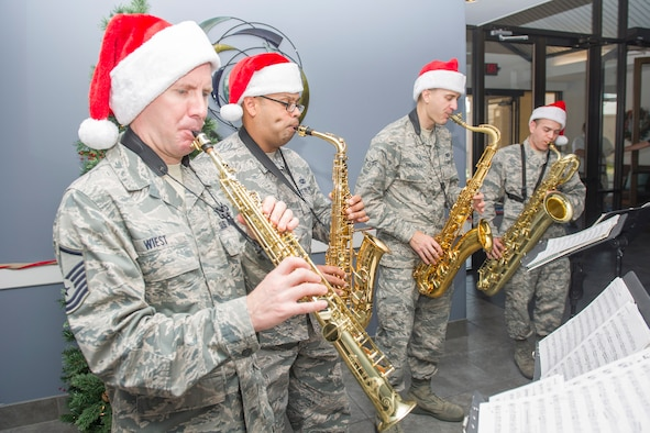 Members of the Air Force Band of the West saxophone quartet visited here to showcase their holiday music Dec. 14, 2016, at Patrick Air Force Base and Cape Canaveral Air Force Station, Fla. The band performed at the Fire Station, Morrell Operations Center, food court, Shark Tank, lodging, Child Development Center, Riverside Dining Facility, Base Exchange, and Commissary. (U.S. Air Force photo/Matthew Jurgens)